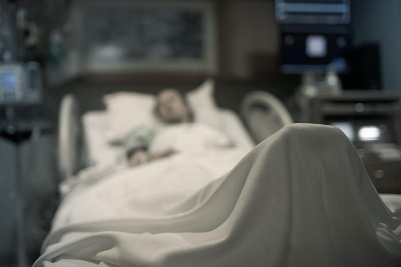 Sick woman lying in the hospital bed. (Photo: kieferpix via Getty Images)