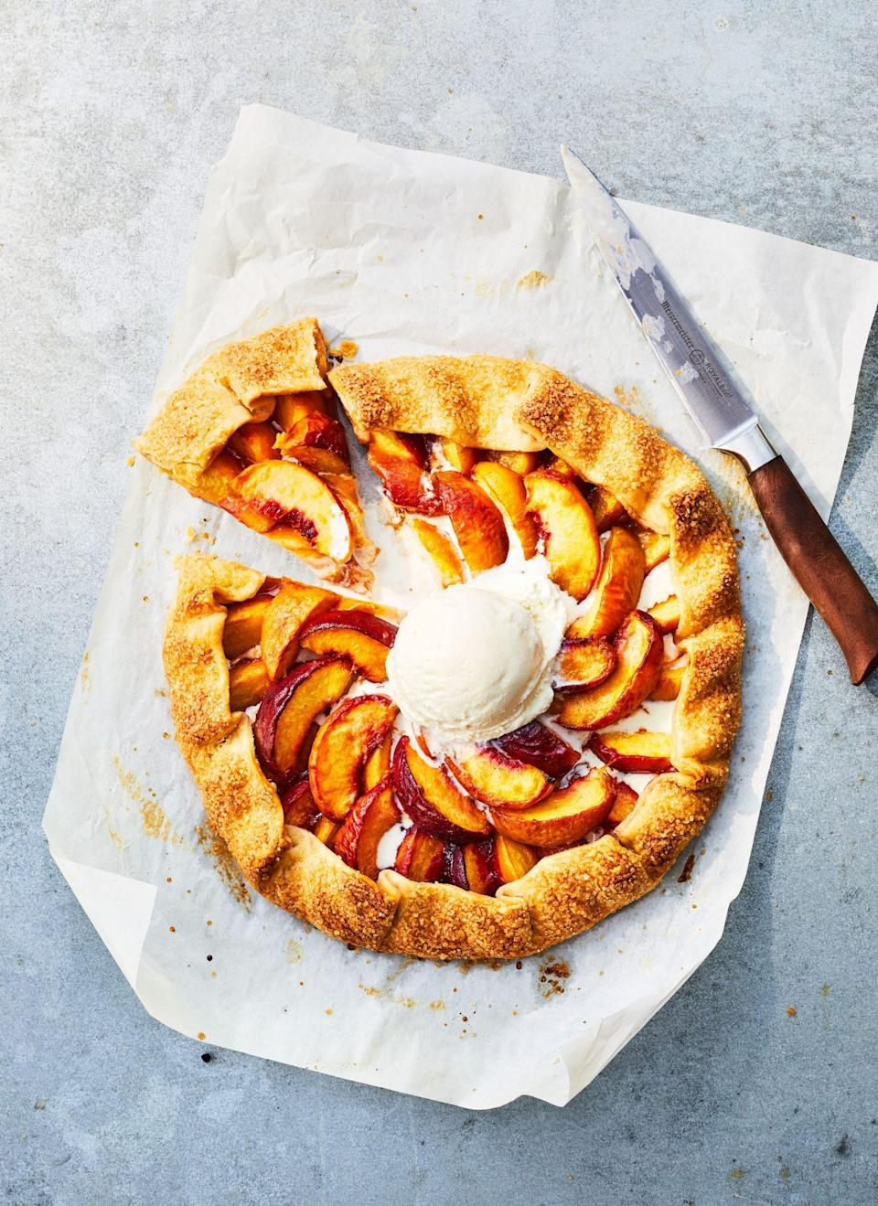 """<p><strong>Recipe: </strong><a href=""""https://www.southernliving.com/recipes/gingered-peach-galette"""" rel=""""nofollow noopener"""" target=""""_blank"""" data-ylk=""""slk:Gingered Peach Galette"""" class=""""link rapid-noclick-resp""""><strong>Gingered Peach Galette</strong></a></p> <p>""""My grandmother's favorite way to use up peaches, tomatoes, or pretty much anything she'd found at the summer farmers' market is by slapping it on some pastry and baking it into a galette. It's quick, easy, and doesn't have to be perfectly pretty. It really lets in-season product shine. She's been known to throw ginger into her peach galette, so this recipe feels just like her."""" Kaitlyn Yarborough, Assistant Editor</p>"""