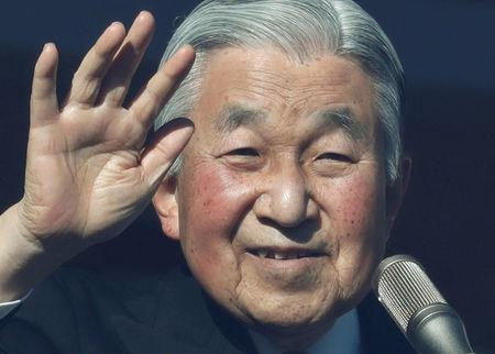 Japan's Emperor Akihito waves to well-wishers who gathered at the Imperial Palace to mark his 84th birthday in Tokyo