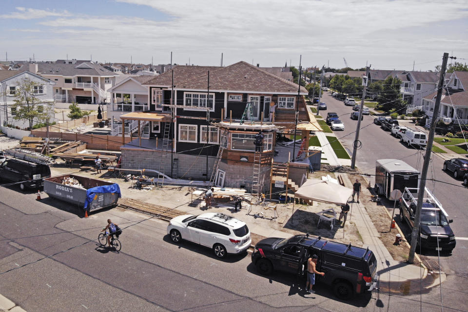 In this image from a drone, workers construct a new house elevated with cinder blocks in Stone Harbor, N.J., on Thursday, July 23, 2020. (AP Photo/Ted Shaffrey)