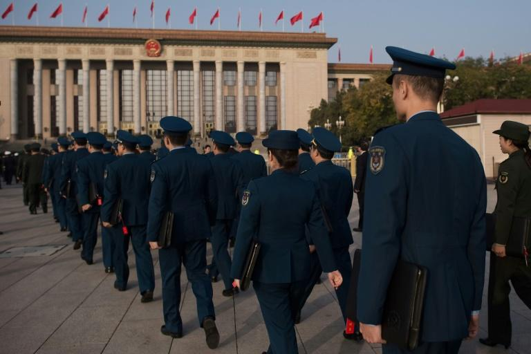 Delegates arrive outside the Great Hall of the People for the closing session of the party congress