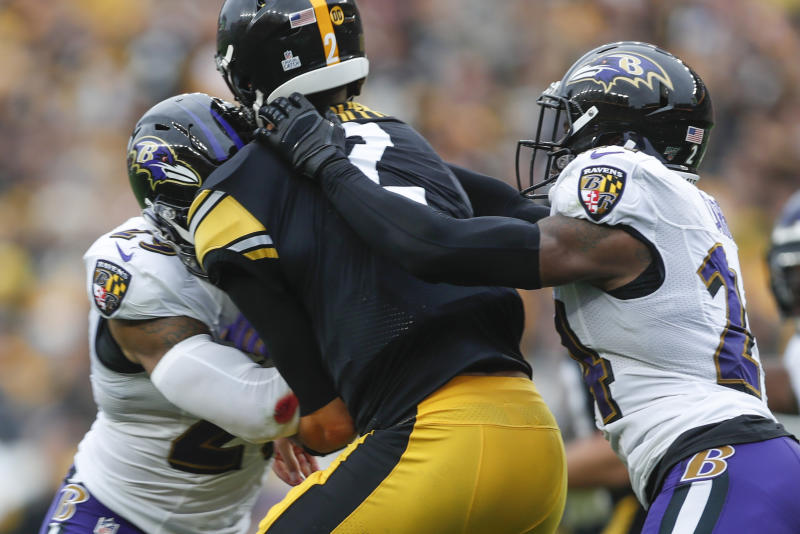Pittsburgh Steelers quarterback Mason Rudolph (2) is hit by Baltimore Ravens free safety Earl Thomas (29), left, and cornerback Brandon Carr (24) during the second half of an NFL football game, Sunday, Oct. 6, 2019, in Pittsburgh. (AP Photo/Don Wright)