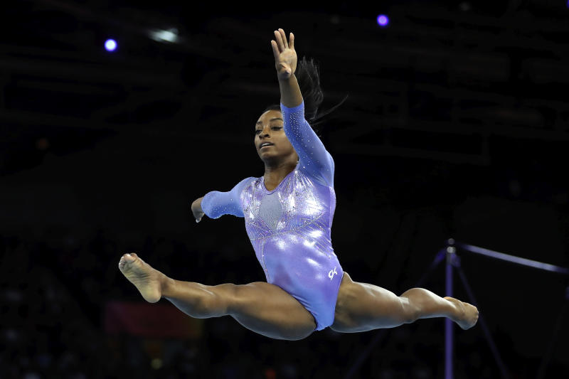 Gold medalist Simone Biles of the United States performs on the floor in the women's apparatus finals at the Gymnastics World Championships in Stuttgart, Germany, Sunday, Oct. 13, 2019. (AP Photo/Matthias Schrader)
