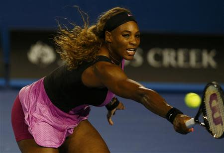 Serena Williams of the United States hits a return to Ashleigh Barty of Australia during their women's singles match at the Australian Open 2014 tennis tournament in Melbourne January 13, 2014. REUTERS/David Gray