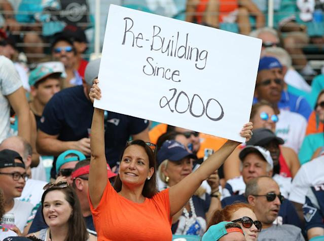 """A <a class=""""link rapid-noclick-resp"""" href=""""/nfl/teams/miami/"""" data-ylk=""""slk:Miami Dolphins"""">Miami Dolphins</a> fan as they play the New England Patriots on Sunday, Sept. 15 2019 at Hard Rock Stadium in Miami Gardens, Florida. (Getty Images)"""