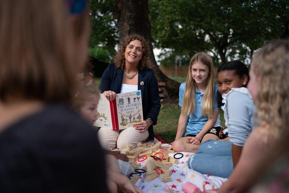 Captain Sir Tom Moore's daughter Hannah Ingram-Moore reads to children who feature in One Hundred Reasons to Hope. (Joe Giddens/ PA) (PA Wire)