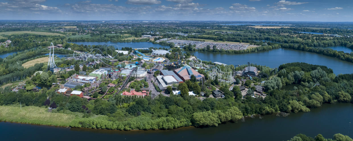 SURREY, ENGLAND - JUNE 2018 An aerial view of Thorpe Park Resort, on June 21st. This large Surrey based theme park is surrounded by Abbey, Fleet and Manor Lakes, in the shadow of the M25 Motorway, 1 mile north west of Chertsey.  Aerial photograph taken by David Goddard