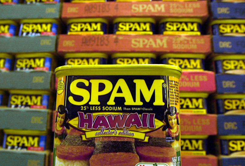 """FILE - This March 3, 2004 file photo shows a collector's limited edition """"Hawaii"""" can of Spam, with a hula doll on both sides of the can and a picture of three pieces of spam musubi in Kailua, Hawaii. Cans of Spam have become a common item that's being stolen from Honolulu stores and then sold on the streets for quick cash, according to authorities. The state's love affair with Spam began during World War II, when rationing created just the right conditions for the rise of a meat that needs no refrigeration and has a remarkably long shelf life (indefinitely, the company says). (AP Photo/Lucy Pemoni, File)"""