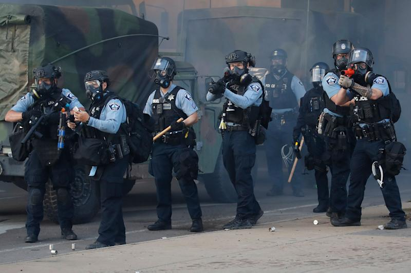 Police fire tear gas and less-lethal rounds at protesters during a demonstration on May 29, 2020 in St. Paul, Minn.