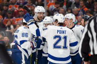 Tampa Bay Lightning players celebrate a goal against the Edmonton Oilers during the first period of an NHL hockey game Saturday, Dec. 22, 2018, in Edmonton, Alberta. (Codie McLachlan/The Canadian Press via AP)