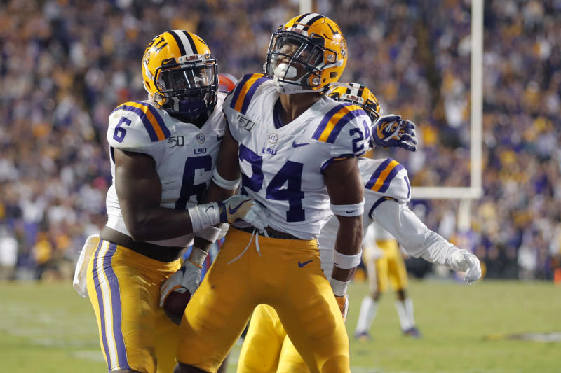 LSU cornerback Derek Stingley Jr. (24) celebrates his interception with linebacker Jacob Phillips (6) in the second half of an NCAA college football game against Florida in Baton Rouge, La., Saturday, Oct. 12, 2019. LSU won 42-28. (AP Photo/Gerald Herbert)