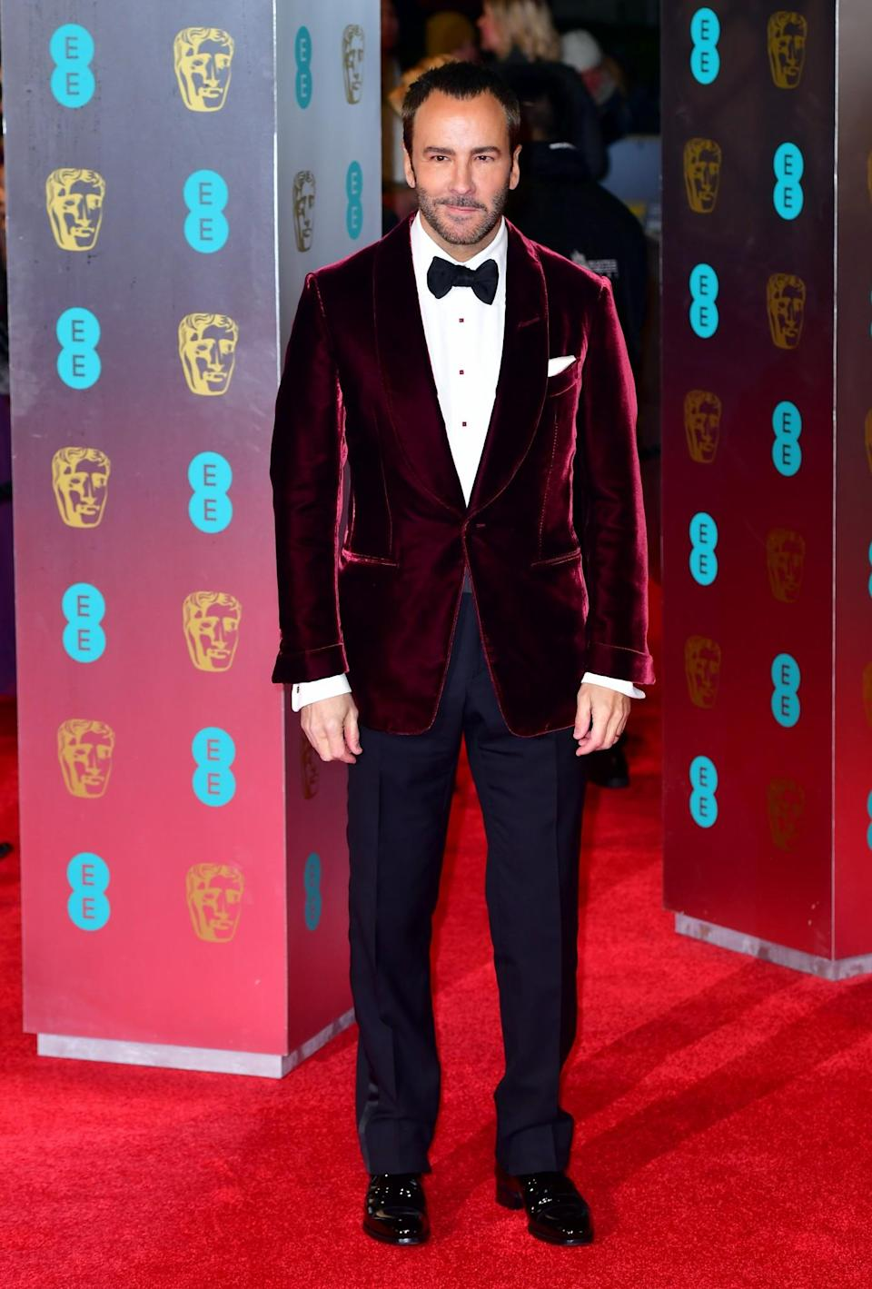 <p>Wearing a velvet jacket of his own design. [Photo: PA] </p>