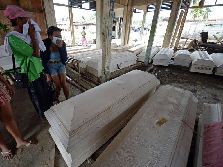 At least 548 people have been killed inTyphoon Bopha, with 500 missing