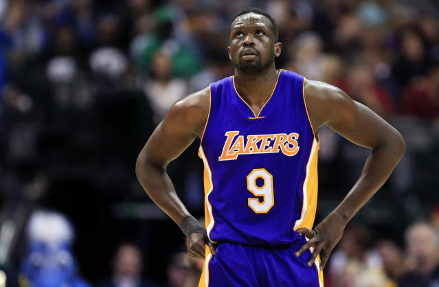 "<a class=""link rapid-noclick-resp"" href=""/nba/players/3824/"" data-ylk=""slk:Luol Deng"">Luol Deng</a> is set to become a free agent after he and the <a class=""link rapid-noclick-resp"" href=""/nba/teams/lal"" data-ylk=""slk:Lakers"">Lakers</a> agreed to a buyout on the remaining two years of his contract. (AP Photo)"