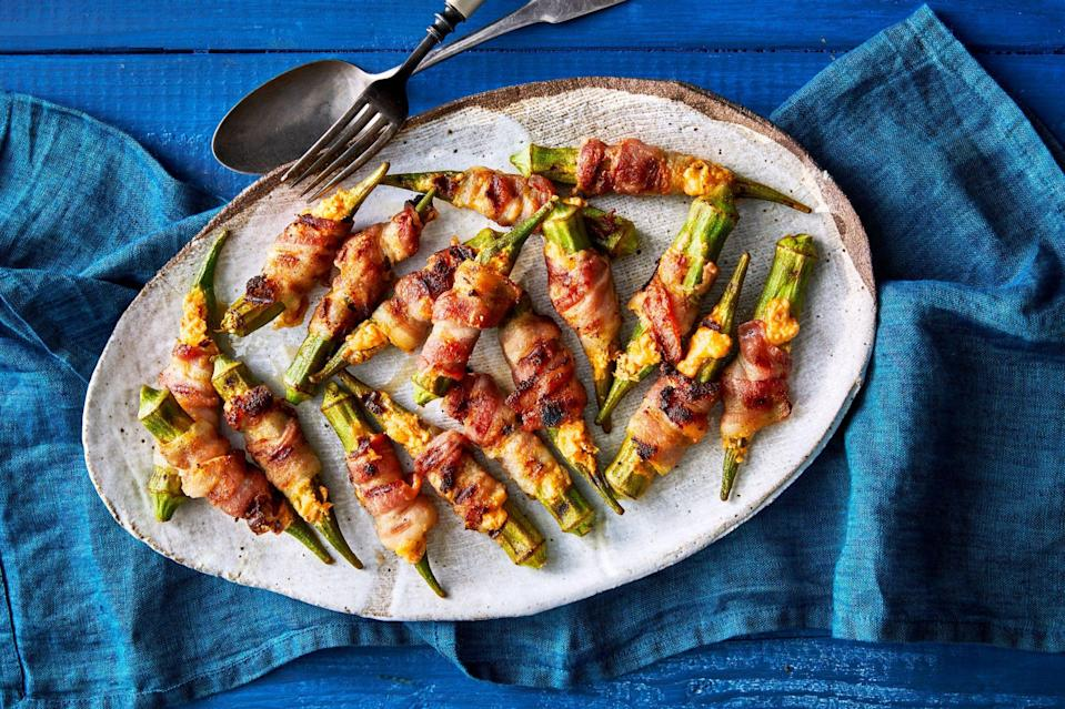"<p><strong>Recipe: </strong><a href=""https://www.southernliving.com/recipes/stuffed-okra-poppers"" rel=""nofollow noopener"" target=""_blank"" data-ylk=""slk:Stuffed Okra Poppers"" class=""link rapid-noclick-resp""><strong>Stuffed Okra Poppers</strong></a></p> <p>We put a Southern spin on jalapeno poppers with okra and a pimiento cheese-like filling. This recipe turned out to be the appetizer of the summer. </p>"