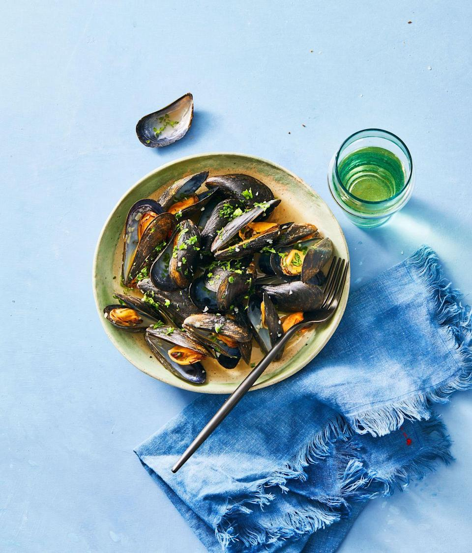 """<p>Mussels might seem like they're too delicate and finicky for a quick weeknight meal. Believe it or not, a fresh batch can be steamed to perfection in just 20 minutes. Added bonus: Save the extra wine for a sip or two.</p><p><a href=""""https://www.goodhousekeeping.com/food-recipes/cooking/a31930645/how-to-cook-mussels-recipe/"""" rel=""""nofollow noopener"""" target=""""_blank"""" data-ylk=""""slk:Get the recipe for White Wine Mussels »"""" class=""""link rapid-noclick-resp""""><em>Get the recipe for White Wine Mussels »</em> </a></p>"""