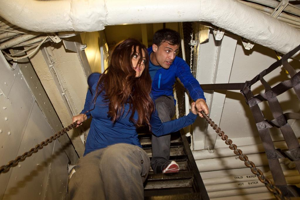 "Contestants Salah and Jeanan from ""The Great Escape,"" on the aircraft carrier the USS Hornet in Oakland, California."