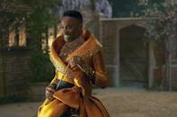 """<p>In this version of Cinderella's story, the role of the fairy godmother, now named Fab G, was filled by Porter. When we're first introduced to his character, he's dressed in a stunning gold and black long-sleeved gown. """"We didn't want to lose Billy, for a start, because he has a great look,"""" said Martin. On his eyes, he wore cat-eye liner and feather-like faux lashes, but Martin explained they didn't want to give him a drag look - instead, they wanted to normalize a man wearing makeup just because. """"It's just a man in makeup with a fabulous dress.""""</p>"""