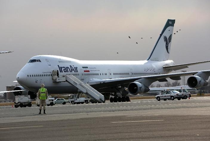 An Iran Air Boeing 747 passenger plane sits on the tarmac of the domestic Mehrabad airport in Tehran on January 15, 2013 (AFP Photo/Behrouz Mehri)