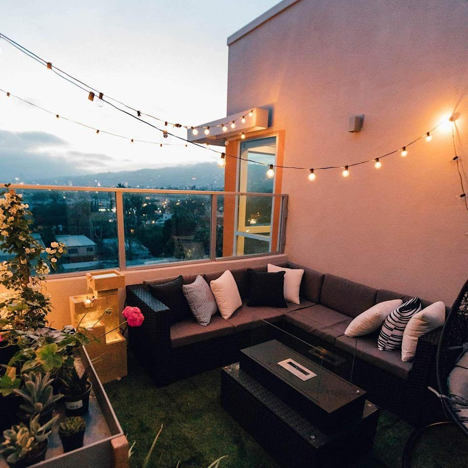 """Turn your balcony, backyard or patio into a twinkling paradise with these beauties that'll look so gorgeous when the sun goes down.<br /><br /><strong>Promising review:</strong>""""These are so cute and perfect! I have a decent-sized balcony and have been looking to turn it into a relaxing area. I got my lights within a few days and I immediately opened up my package, everything was there, no broken bulbs and a spare bulb. I then tested out the power and<strong>these lights are perfectly bright and still set a very calming and intimate scene.</strong>"""" —<a href=""""https://amzn.to/2QnL4jm"""" target=""""_blank"""" rel=""""nofollow noopener noreferrer"""" data-skimlinks-tracking=""""5580838"""" data-vars-affiliate=""""Amazon"""" data-vars-href=""""https://www.amazon.com/gp/customer-reviews/R1AF0EV1NCCZGT?tag=bfgenevieve-20&ascsubtag=5580838%2C2%2C33%2Cmobile_web%2C0%2C0%2C1159949"""" data-vars-keywords=""""cleaning,fast fashion"""" data-vars-link-id=""""1159949"""" data-vars-price="""""""" data-vars-product-id=""""16176684"""" data-vars-retailers=""""Amazon"""">Amazon Customer</a><br /><br /><strong>Get them from Amazon for<a href=""""https://amzn.to/3xkJNdu"""" target=""""_blank"""" rel=""""nofollow noopener noreferrer"""" data-skimlinks-tracking=""""5580838"""" data-vars-affiliate=""""Amazon"""" data-vars-asin=""""B07DNQD5XX"""" data-vars-href=""""https://www.amazon.com/dp/B07DNQD5XX?tag=bfgenevieve-20&ascsubtag=5580838%2C2%2C33%2Cmobile_web%2C0%2C0%2C1159934"""" data-vars-keywords=""""cleaning,fast fashion"""" data-vars-link-id=""""1159934"""" data-vars-price="""""""" data-vars-product-id=""""2788050"""" data-vars-product-img=""""https://m.media-amazon.com/images/I/41dS8aNUERL._SL500_.jpg"""" data-vars-product-title=""""Outdoor String Light 50Feet G40 Globe Patio Lights with 52 Edison Glass Bulbs(2 Spare), Waterproof ConnectableHanging Light for Backyard Porch Balcony Deck Party Decor, E12 Socket Base, Black"""" data-vars-retailers=""""Amazon"""">$15.98+</a>(available in three lengths and three colors).</strong>"""
