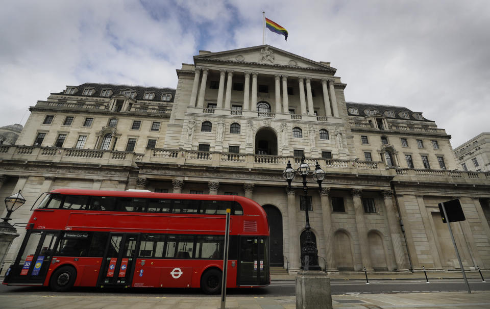 The rainbow flag flies above the Bank of England to celebrate the unveiling of the new fifty pound note in London, Thursday, March 25, 2021. The new £50 banknote features the scientist Alan Turing. Following its public unveil today, the polymer £50 will be issued for the first time on June 23, 2021, which coincides with Alan Turing's birthday. (AP Photo/Kirsty Wigglesworth)