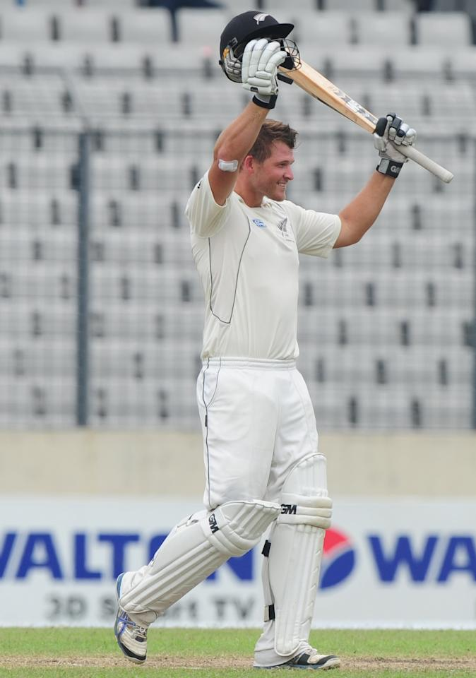 New Zealand batsman Corey Anderson reacts after scoring a century (100 runs) during the third day of the second cricket Test match between Bangladesh and New Zealand at the Sher-e Bangla National Stadium in Dhaka on October 23, 2013. AFP PHOTO/ Munir uz ZAMAN        (Photo credit should read MUNIR UZ ZAMAN/AFP/Getty Images)