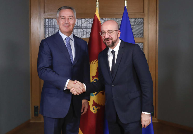 Montenegro's President Milo Dukanovic, left, is welcomed by European Council President Charles Michel prior to a meeting at the Europa building in Brussels, Monday, Feb. 17, 2020. (Stephanie Lecocq, Pool Photo via AP)