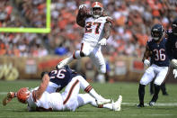 Cleveland Browns running back Kareem Hunt (27) jumps over players during the first half of an NFL football game against the Chicago Bears, Sunday, Sept. 26, 2021, in Cleveland. (AP Photo/David Dermer)