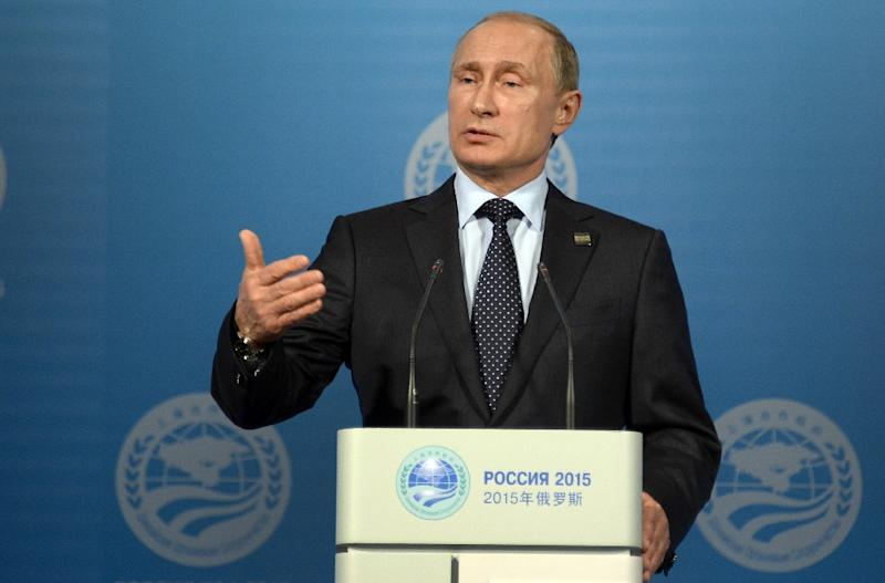 Russian President Vladimir Putin speaks at a press conference after the Shanghai Cooperation Organization (SCO) summit in Ufa, Russia on July 10, 2015 (AFP Photo/Alexander Nemenov)
