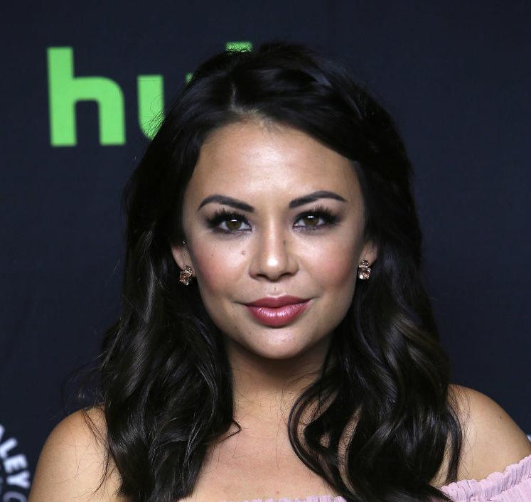 """Janel Parrish's mini looks like a scrumptious pastel cupcake holder at the """"Pretty Little Liars"""" Paleyfest Panel"""
