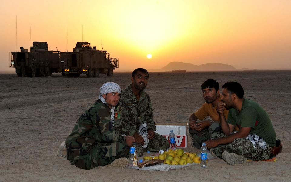 Afghan soldiers working and fighting alongside British forces, rest after a day's patrol through Helmand.  - Rupert Frere RLC/Crown Copyright