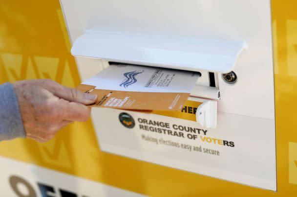 PHOTO: A voter drops ballots for the March 3 Super Tuesday primary into a mobile voting mail box in Laguna Woods, Calif., Feb. 24, 2020. (Mike Blake/Reuters, FILE)