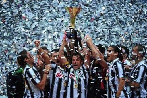 Juventus captain Alessandro Del Piero (C) holds the Serie A trophy, the Scudetto, after they defeated Atalanta on May 13. Champions Juventus broke AC Milan's record of 42 matches unbeaten and finished the league season undefeated with a 3-1 win over Atalanta