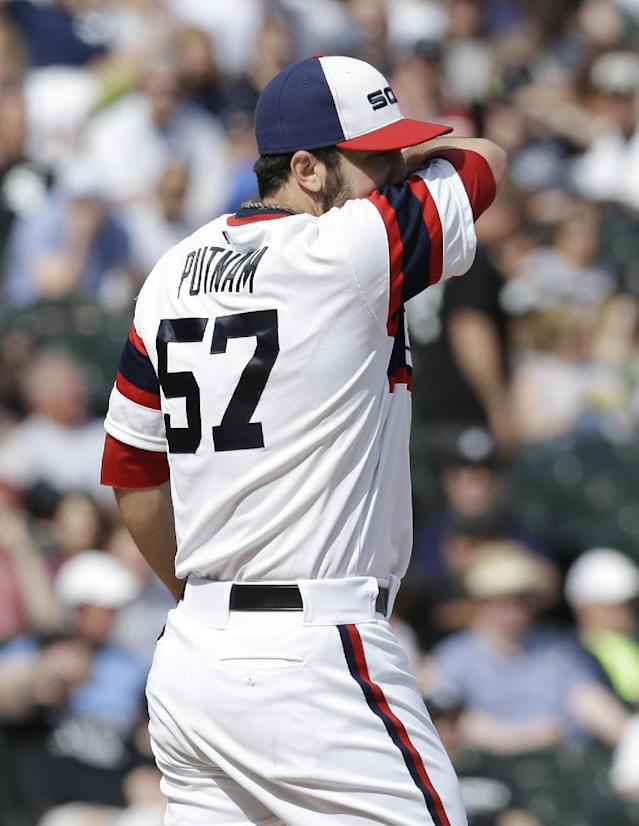 Chicago White Sox relief pitcher Zach Putnam wipes his face during the 10th inning of a baseball game against the New York Yankees in Chicago on Saturday, May 24, 2014. The Yankees won 4-3. (AP Photo/Nam Y. Huh)