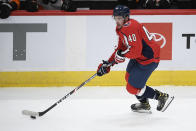 Washington Capitals center Garrett Pilon skates with the puck during the third period of the team's NHL hockey game against the Philadelphia Flyers, Saturday, May 8, 2021, in Washington. The Capitals won 2-1 in overtime. (AP Photo/Nick Wass)