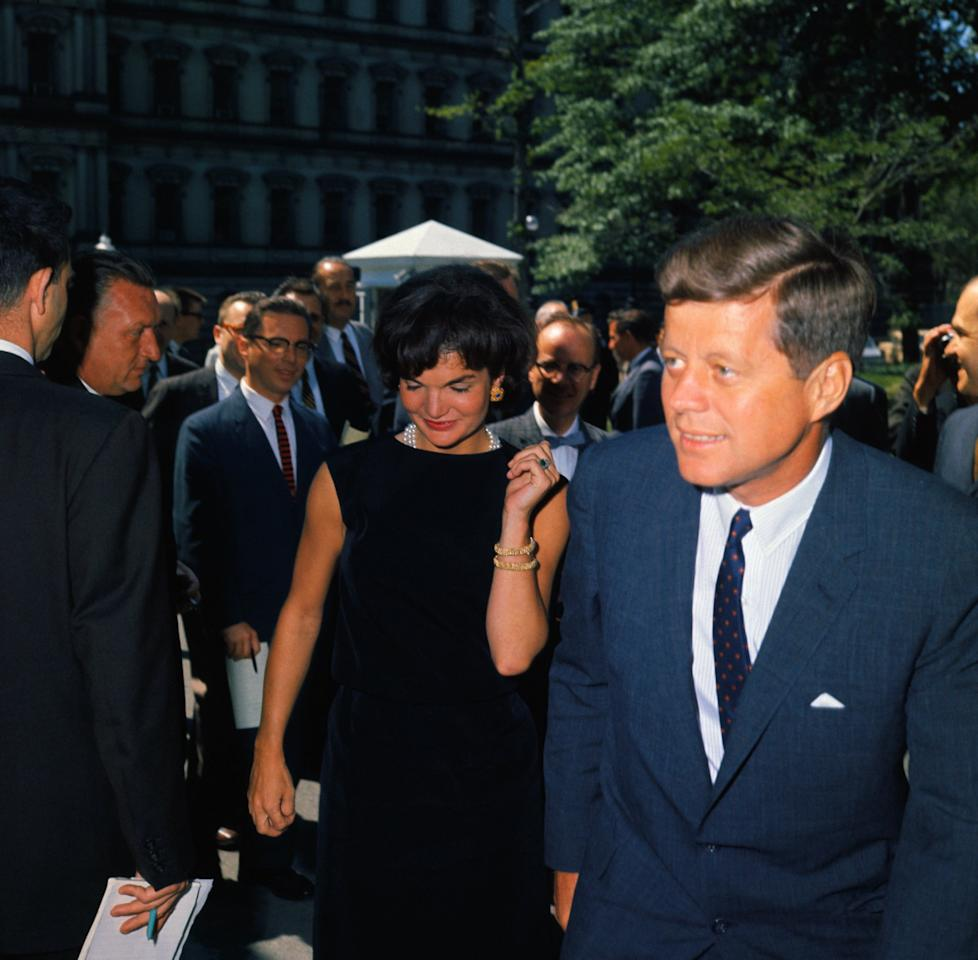 <p>In 1961, Jackie wore her engagement ring with a boat-neck LBD and pearls in Washington, DC.</p>