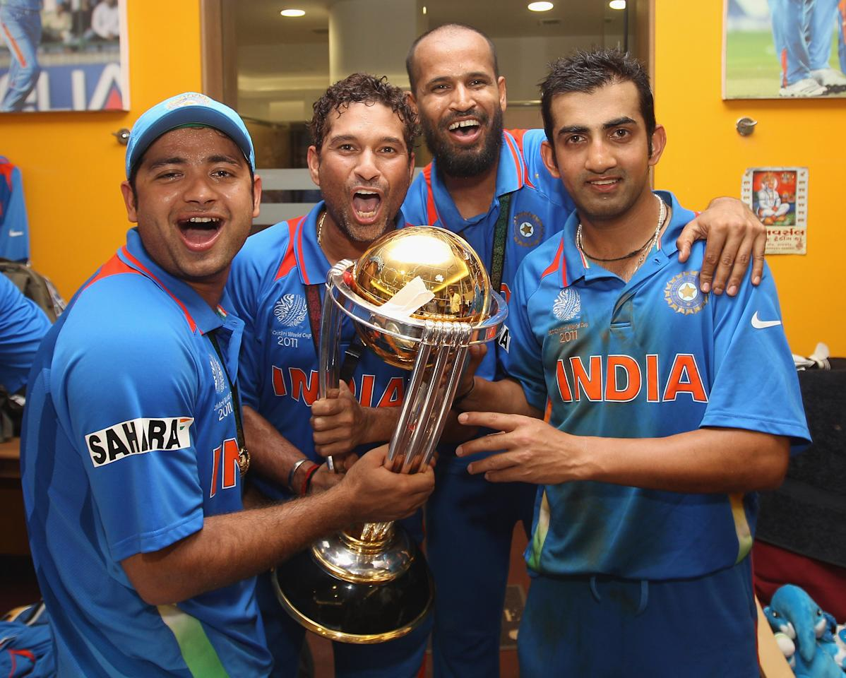 MUMBAI, INDIA - APRIL 02:  Piyush Chawla (L), Sachin Tendulkar (2L),Yusuf Pathan (2R) and Gautam Gambhir (R) in the dressing room with the winners trophy during the 2011 ICC World Cup Final between India and Sri Lanka at Wankhede Stadium on April 2, 2011 in Mumbai, India.  (Photo by Michael Steele/Getty Images)