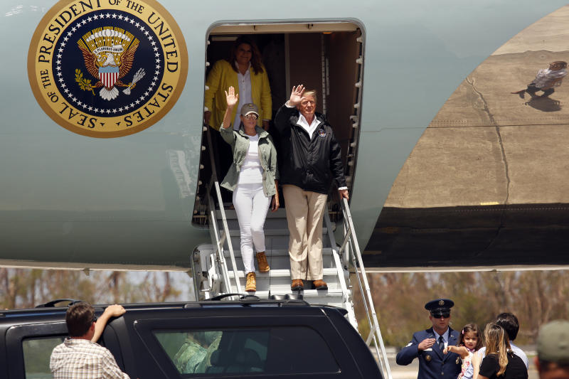U.S. President Donald Trump and the first lady Melania Trump arrive at the Muniz Air National Guard Base in Puerto Rico on Tuesday. (Carolyn Cole via Getty Images)
