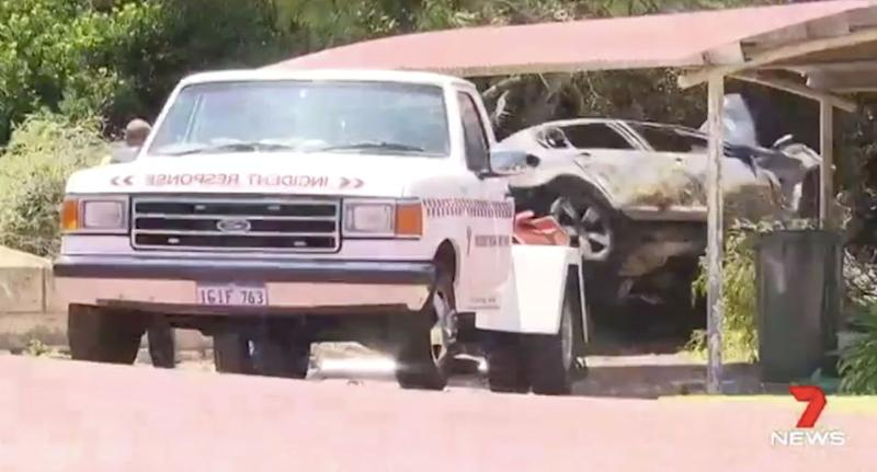 The crashed car is towed away by emergency services. Source: 7 News