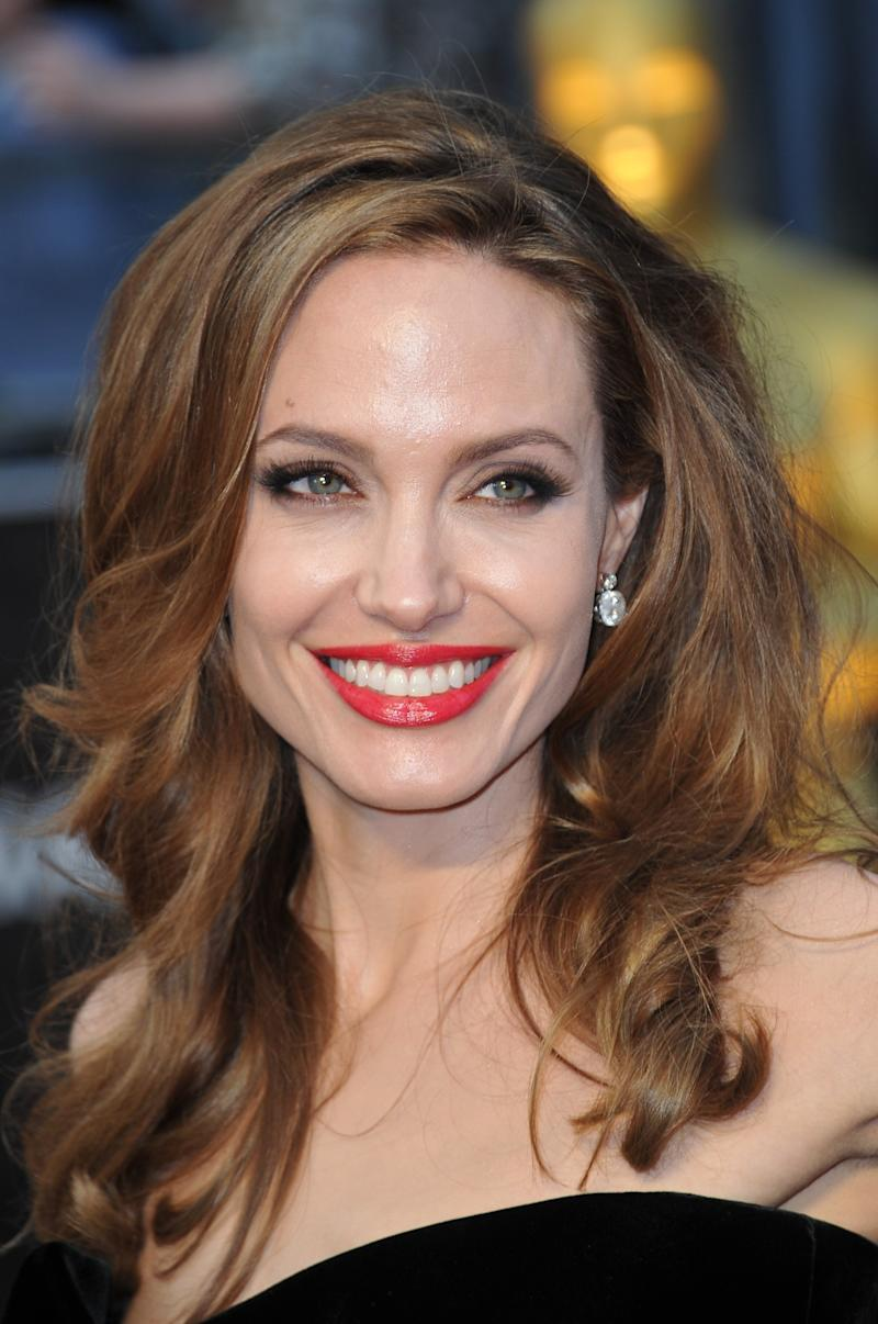 An undone soft blowout and some glossy red lips made for a glamorous moment. Angelina Jolie at the 84th annual Academy Awards in Hollywood, California, February 2012. Photo by Joe Klamar/AFP/Getty Images.