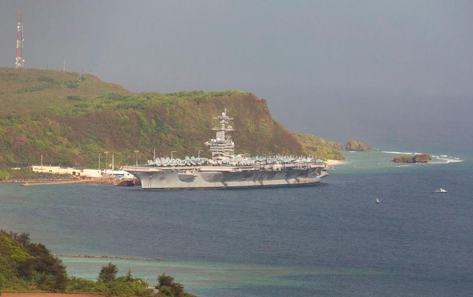 The USS Theodore Roosevelt docked at Naval Base Guam in Apra Harbor on April 27. (Photo: TONY AZIOS via Getty Images)