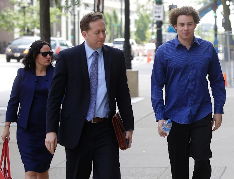 Marcus Hutchins (R), seen ahead of a 2017 court appearance, was hailed as a hero for stemming the WannaCry ransomware outbreak but later charged in the US with creating malware that could attack the banking system