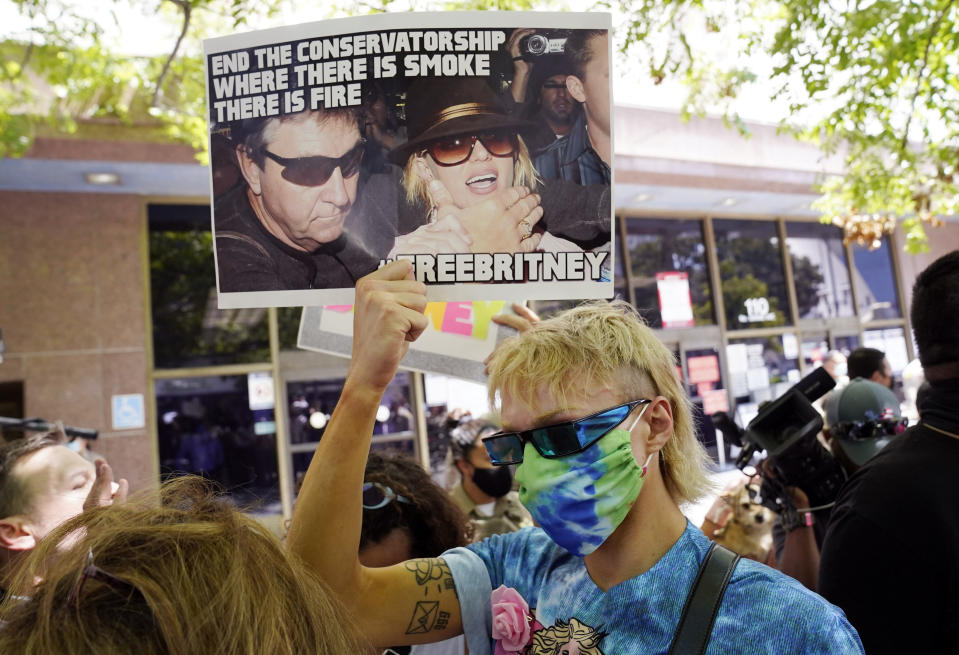Britney Spears supporter Biblegirl holds a sign outside a court hearing concerning the pop singer's conservatorship at the Stanley Mosk Courthouse, Wednesday, June 23, 2021, in Los Angeles. (AP Photo/Chris Pizzello)
