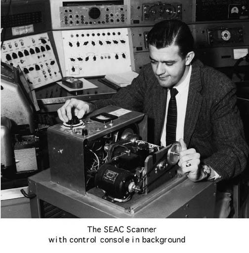 An archival image of a computer scientist in 1957 working on the first scanned image.