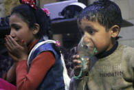 <p>This image released early Sunday, April 8, 2018 by the Syrian Civil Defense White Helmets, shows a child receiving oxygen through respirators following an alleged poison gas attack in the rebel-held town of Douma, near Damascus, Syria. (Photo: Syrian Civil Defense White Helmets via AP) </p>