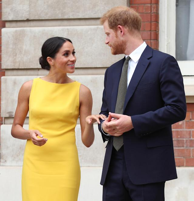 <p>The Duchess of Sussex opted for a slick low bun on July 6 at the Commonwealth Youth Forum reception in London, which led us to ask: Is she growing out her now-famous tendrils? (Photo: Getty Images) </p>