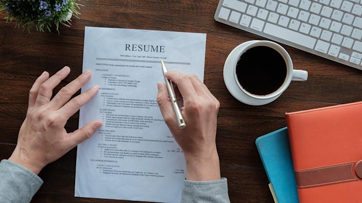 man with resume paper