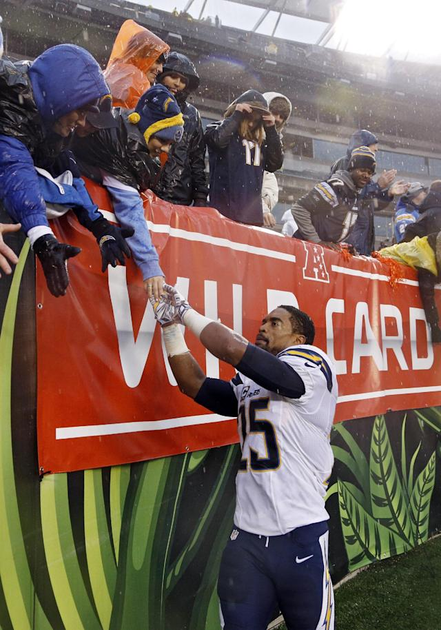 San Diego Chargers safety Darrell Stuckey greets fans after a 27-10 win over the Cincinnati Bengals in an NFL wild-card playoff football game on Sunday, Jan. 5, 2014, in Cincinnati. (AP Photo/David Kohl)