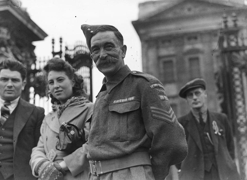 <p>A Home Guard soldier waits outside Buckingham Palace for a medals presentation.</p>