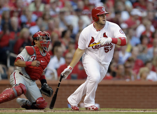 St. Louis Cardinals' Matt Adams watches his two-run single in front of Philadelphia Phillies catcher Carlos Ruiz during the second inning of a baseball game Wednesday, July 24, 2013, in St. Louis. (AP Photo/Jeff Roberson)